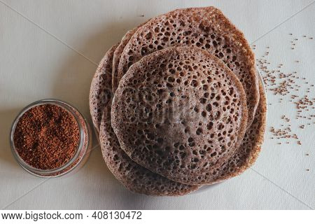 Hoppers Made Of Finger Millet Also Known As Ragi In India. Home Made Healthy Food Shot On White Back