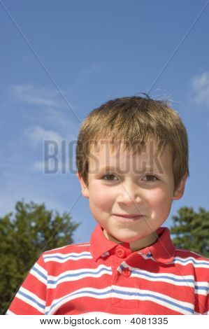 Happy Young Boy In Striped Shirt