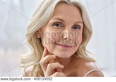 Smiling Happy Attractive 50s Middle Aged Mature Blond Woman, Old Lady Looking At Camera Advertising