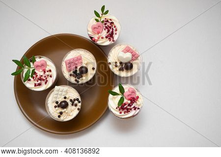 Trifles Portioned Mini Cakes On Plate. Layered Trifle Dessert With Whipped Cream And Chocolate. Flat