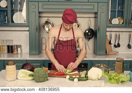 Cooking Healthy And Tasty Food. Bearded Man Enjoy Cooking Natural Food. Sexy Naked Chef Cook Prepare