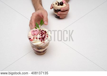 Trifle Portioned Cake. Layered Trifle Dessert With Sponge Cake, Whipped Cream And Chocolate In Hands