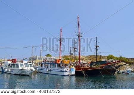 Hersonissos, Crete, Greece - June 11, 2019 : Tourist Cruise Ships In Hersonissos Harbour A Popular T