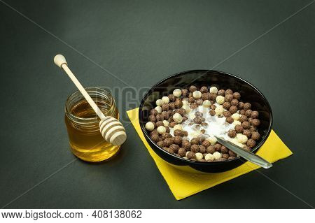 Round Chocolate Flakes With Milk, Healthy Breakfast. Balls Of Chocolate Flakes In A Bowl And Milk. S