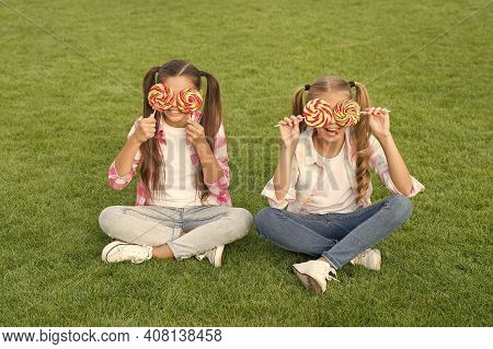 Not Only Sweet But Gorgeous To Look At. Little Girls With Sweet Look On Green Grass. Happy Children