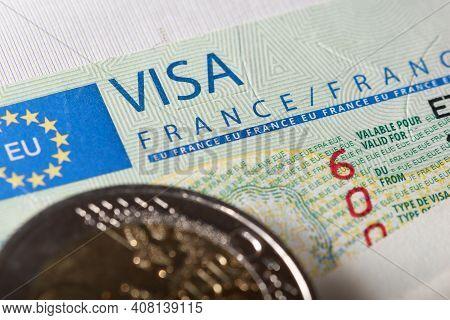 Schengen Visa In Passport Issued By The French Embassy. This Sample Of The Schengen Visa Has Been Pu