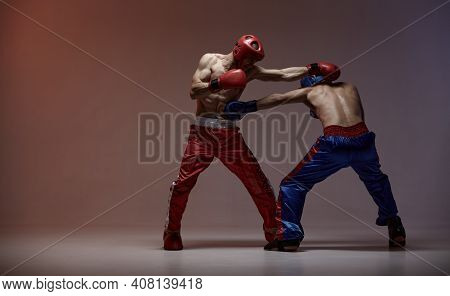 Sparring Of Two Fighting Males In Boxing Gloves During Battle, Martial Arts, Mixed Fight Concept