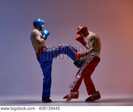 Boxers, Fighting Males In Helmets And Boxing Gloves In Blue Red Light In Studio, Martial Arts, Mixed
