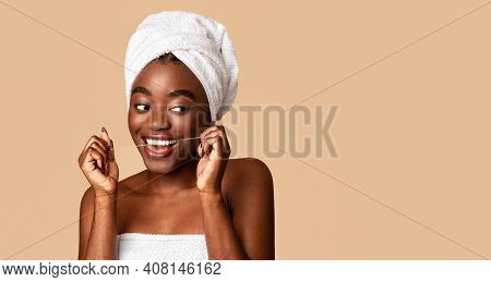 Oral Hygiene And Health Care Concept. Portrait Of Smiling Confident Black Woman Using Dental Floss,