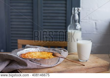 Cottage Cheese Casserole With Cup Of Milk On Wooden Table Background. Cottage Cheese Casserole.