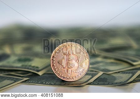 Golden Symbolic Coin Bitcoin On Banknotes Of Dollars. Exchange Bitcoin Cash For A Dollars. Cryptocur