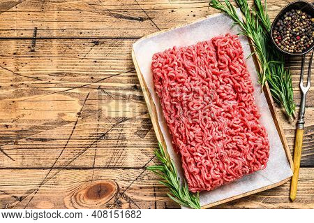 Raw Mince Ground Meat. Wooden Background. Top View. Copy Space
