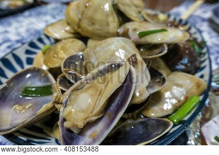 Close-up Of A Plate Of Cooked Clams In A Special Chinese-style Sauce As Served In Cantonese Restaura