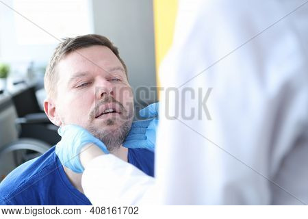 Doctor Examines Patients Thyroid Gland In Medical Office. Thyroid Disease Concept
