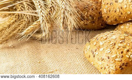 Loaf Bread. Rye Bakery With Crusty Loaves And Crumbs. Fresh Loaf Of Rustic Traditional Bread With Wh