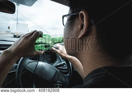 Man Driver Drinking Alcohol And Drunk While Driving A Car, Drunken Man Loose Control And Vitsual Vis
