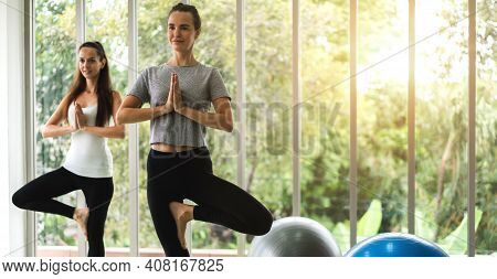 Portrait Of Sport Attractive People Woman In Sportswear Relax And Practicing Yoga Fitness Exercise W