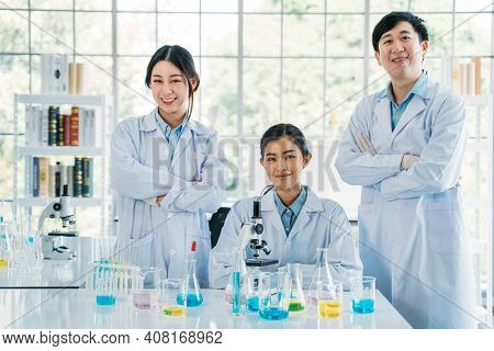 Portrait Of Successful Team Of Male And Female Asian Medical Researcher And Scientist Working In Med