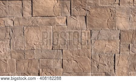 A Fragment Of A Wall Or Fence Finished With Red Natural Stone With Preserved Texture, Rectangular Ti