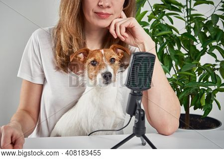 Woman Recording Podcast With Her Dog. Remote Work At Home. Pet Care