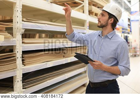 Manager Use His Tablet For Online Checking Products Available.