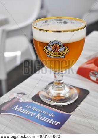 NANTES, FRANCE - CIRCA AUGUST 2011: A glass of Grimbergen beer served at La Taverne de Maitre Kanter