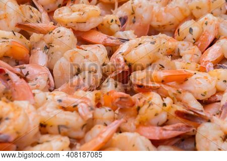 Process Of Grilling Shrimps, Prawns On Brazier At Summer Local Food Market - Close Up View. Outdoor