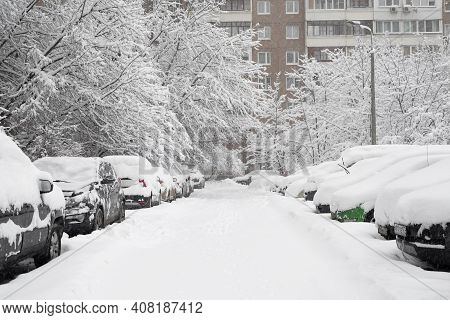 Moscow, Russia - Feb 04.2018. Cars In The Yard Of House During Heavy Snowfall