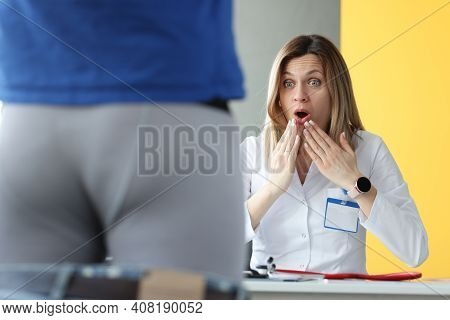 Woman Doctor Examining Patient In Shorts And Is Surprising. Diagnosis Of Sexually Transmitted Infect