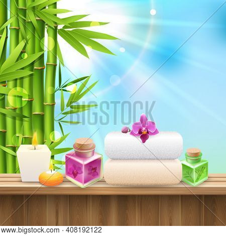 Colorful Spa Composition With Set For Spa Treatment And Bamboo Shoots On Blue Sky Background Realist