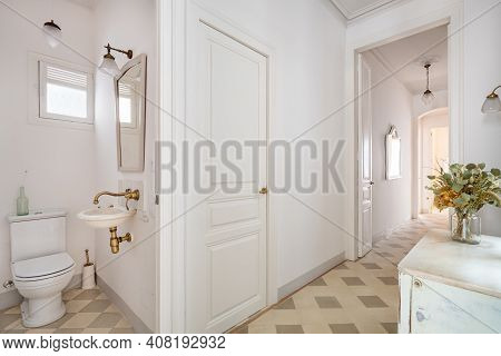 Hallway Decorated In Vintage Style With View To Small Toilet And Other Spaces Of Refurbished Apartme