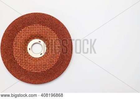 Abrasive Wheel, Grinding Disc Of Orange, Brown Color, Isolated On White Background. Abrasive Materia