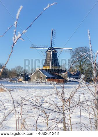 Pelmolen Ter Horst, Rijssen Netherlands During Snowy Weather Snow Covered Wind Mill In The Netherlan