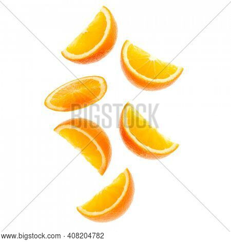 falling fresh orange fruit slices isolated over white background closeup. Flying food concept. Top view. Flat lay. Orange slice in air, without shadow.