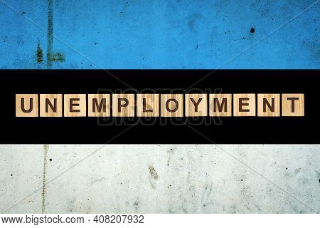 Unemployment. The Inscription On Wooden Blocks On The Background Of The Estonia Flag. Unemployment G