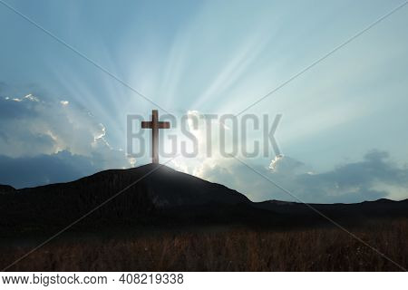 Christian Cross On Hill Outdoors At Sunrise. Resurrection Of Jesus