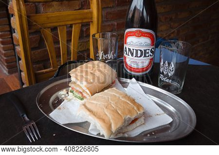 Puente Del Inca, Mendoza, Argentina - January, 2020: Two Sandwiches, Two Glasses And Bottle Of Beer