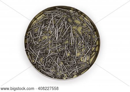 Small Steel Nails With White Anti Corrosion Coating In Round Tin Box On A White Background, Top View