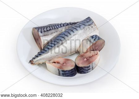 Whole And Several Slices Of Pickled Mild Salted Atlantic Mackerel On White Dish On A White Backgroun