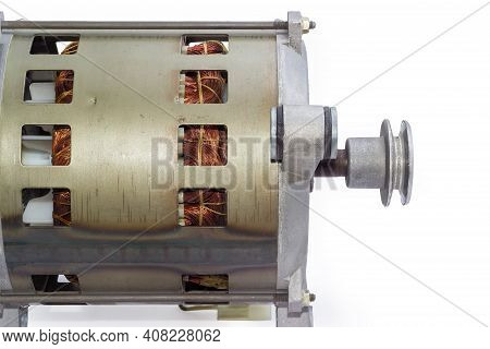 Fragment Of Electric Motor With  Pulley, Visible Windings In Ventilation Holes In The Housing And Sh