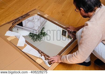 Overhead View Of Male Unboxing In The Large Wooden Parquet Floor New Cardboard With Vintage Luxury W