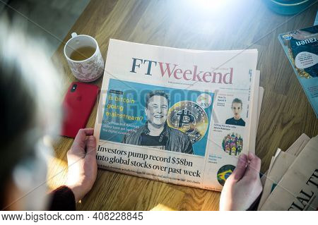 Paris, France - Feb 13, 2021: Pov Business Woman Reading Financial Times Newspaper On Kitchen Counte