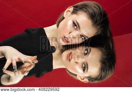 Look On. Portrait Of Young Female Fashion Model With Reflection On Mirrors Around Her Face. Beautifu