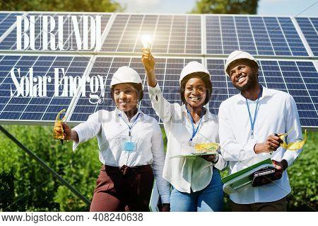 Burundi Solar Energy. African Engineers At Panels Station.