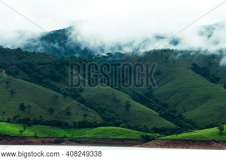Mountains With Clouds Evaporating At The Hilltop After A Rainfall During The Afternoon. Landscape Of