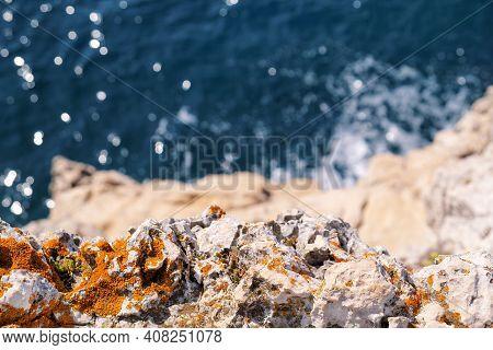 Rocks At Seashore Of Adriatic Sea, Mediterranean, Closeup. Stone, Rocks, Red Algae And Sea, Shore An