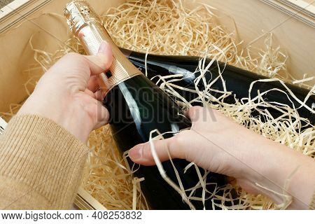 Bottle Of Expensive Elite Wine In A Wooden Box With Shavings,  Online Order And Delivery Wine, Inter