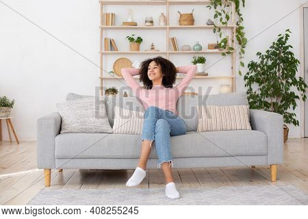 Cleanliness In Apartment, New Home And Positive Emotions. Smiling Young African American Lady Enjoyi