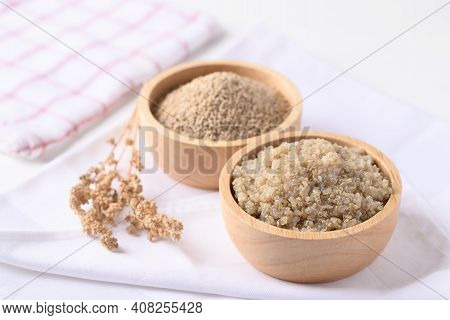 Cooked Brown Quinoa Seeds And Raw Quinoa Seeds In A Wooden Bowl, Healthy Vegan Food