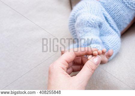Newborn Baby Feet. Motherhood Concept. Mother Day. Copy Space. Newborn Baby Feet. Motherhood Concept